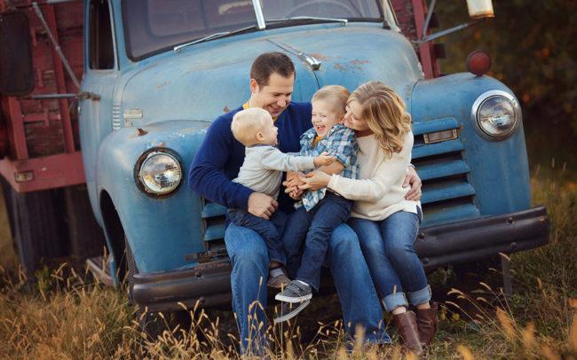 family laughing on blue farm truck lincoln ne