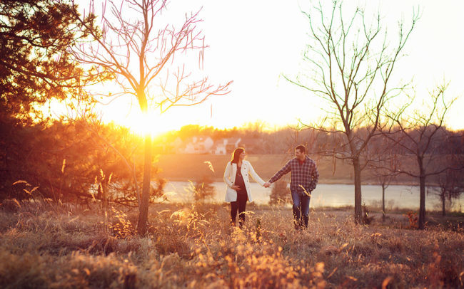 Couple holding hands outdoor maternity session Lincoln Nebraska