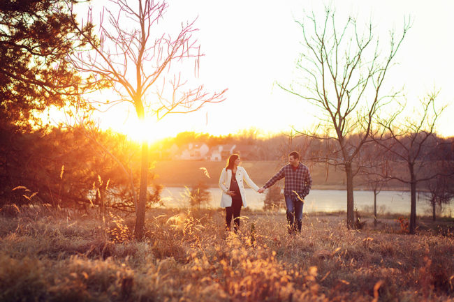 Couple holding hands outdoor maternity session Lincoln Nebraska