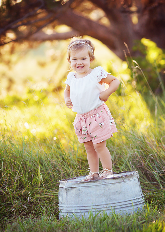 cute girl standing on bucket outdoor kids photo session