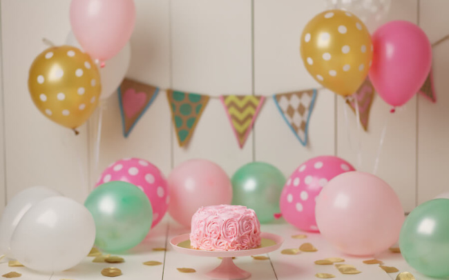 pink rose cake gold balloons first birthday photo session