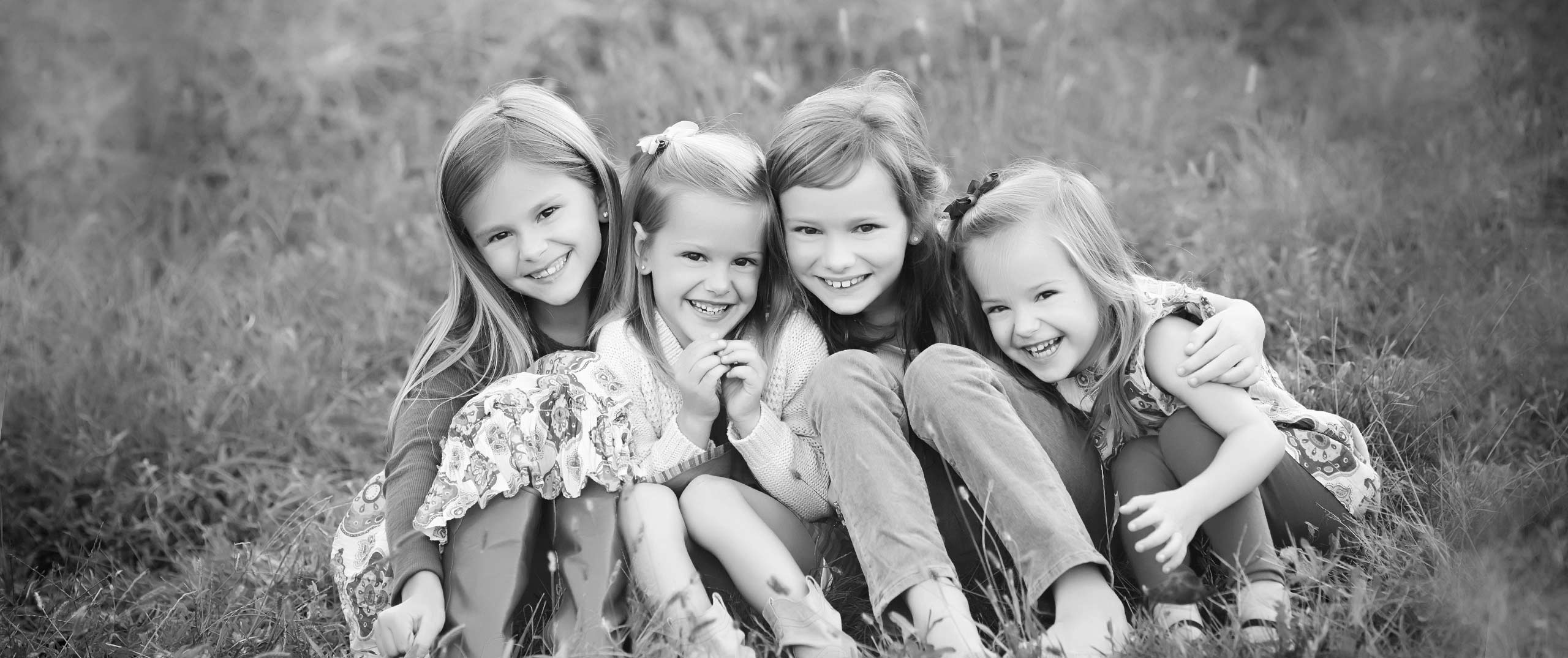 outdoor family photography session four sisters smiling lincoln ne