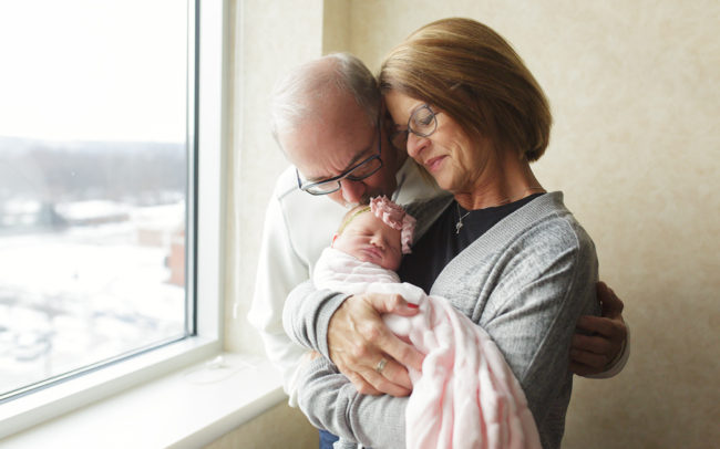 natural light photo of new grandparents holding baby girl lincoln ne