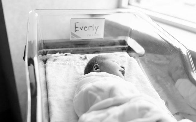 newborn baby girl black and white hospital photo session