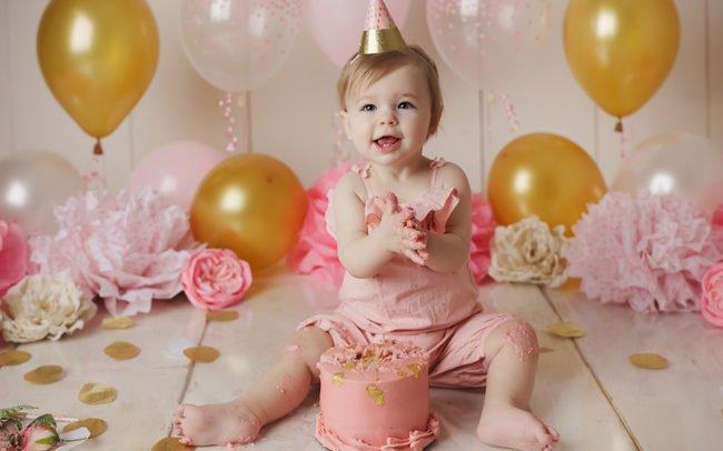cake smash session lincoln ne pink gold flowers