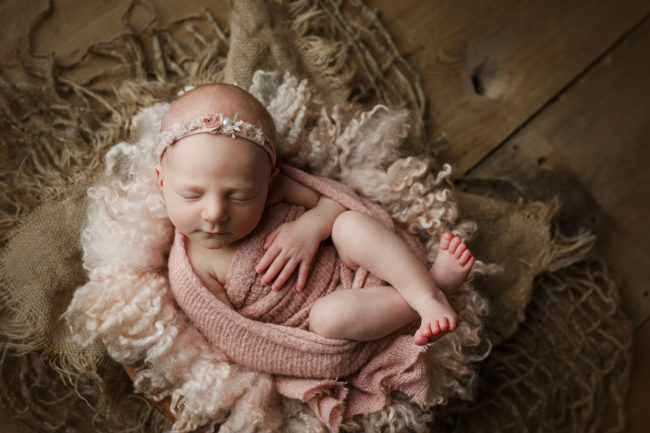 lincoln ne newborn photographer wrapped in pink